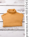 Female new folded sweater, top view. 48597043