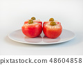 Stuffed tomatoes with rice, cheese and olives 48604858