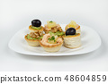Several beautiful tartlets with different fillings 48604859