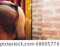 male haircut pigtail, close-up on a nature background. Photo of nape without face. 48605774