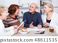 Mature friends are talking about documents 48611535