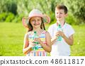 two kids drinking water 48611817