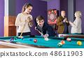 people having pool game 48611903