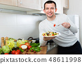 Cheerful handsome man holding plate 48611998
