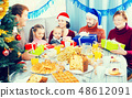 Family exchanging Christmas gifts 48612091