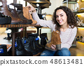 Young woman in a shoe store. 48613481