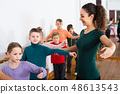 Group of children practicing at the ballet barre 48613543