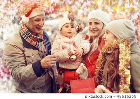 Family buying Christmas decorations 48616259