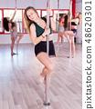 Females pole dancers exercising in studio 48620301