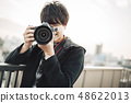Male rooftop photographer 48622013