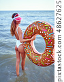 Woman in swimsuit with swim ring 48627625