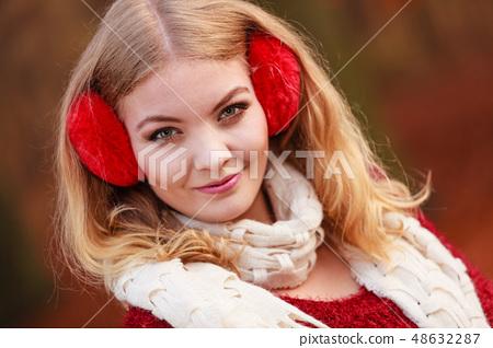 Pretty gorgeous woman in earmuffs. 48632287
