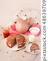 pancakes served with cream and milk. 48639709