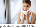 Face Washing. Closeup Of Happy Woman Drying Skin With Towel. High Resolution 48641263