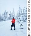 Snowboarder controls the drone 48641735