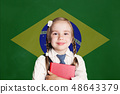 Brazil concept with smiling little girl student 48643379