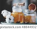 Homemade orange jam in glass jar on blue or grey 48644932