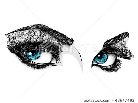 blue eyes of a woman with ornaments 48647492