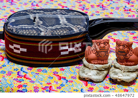 Okinawa Sanshin and Adan sandals and shisa 48647972
