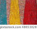 Red, yellow, green and orange tile wall. 48653028