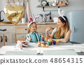Mother with little daughter in a kitchen 48654315