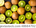 Kiwi on a wooden table top view 48664702