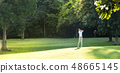 Asian man playing golf on natural golf course 48665145