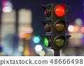 Traffic light closeup in the night city 48666498