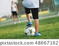 little happy boy on football field 48667162
