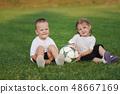 little happy boy on football field 48667169