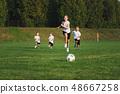little happy children on football field 48667258