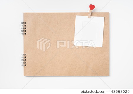 kraft notebook, photo frame and pen on white 48668026