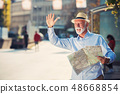 Happy smiling elder man tourist ready for journey, looking for direction. 48668854