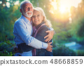 Happy senior couple in love. Park outdoors. 48668859