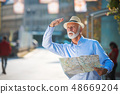 Happy smiling elder man tourist ready for journey, looking for direction. 48669204
