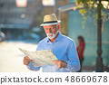 Happy smiling elder man tourist ready for journey, looking for direction. 48669678