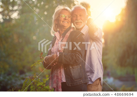 Happy senior couple in love. Park outdoors. 48669694