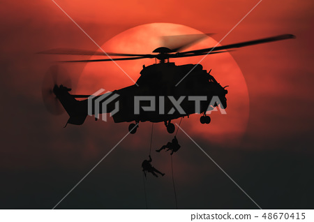 Shot of rescue helicopter hopping 48670415
