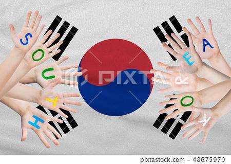 South Korea inscription on the children's hands 48675970