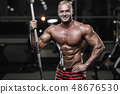 Handsome strong bodybuilder athletic men pumping 48676530