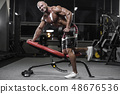 Handsome strong bodybuilder athletic men pumping 48676536