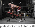 Handsome strong bodybuilder athletic men pumping 48676538