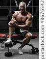 Handsome strong bodybuilder athletic men pumping 48676542