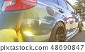 Sunlight reflecting on exterior of a shiny car 48690847