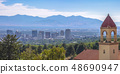 Steeple of a church with a view of Salt Lake City 48690947