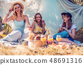 Group of girls friends making picnic outdoor 48691316