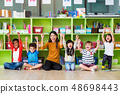 Happy Asian female teacher and mixed race kids 48698443