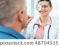 ENT doctor examining patient 48704515