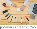 Office table with accessories: white paper, blue and pink marker, black phone, coffee cup, pen 48707527