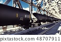 Rail tank cars with oil on the rails at sunrise. Train transportation of tankers. The container of 48707911
